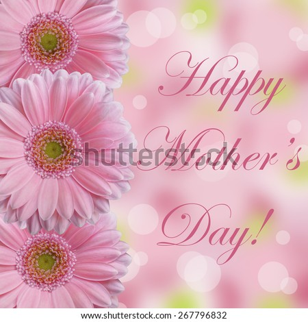 Happy Mother's Day card with three soft light pink gerbera daisy flowers with abstract bokeh background #267796832