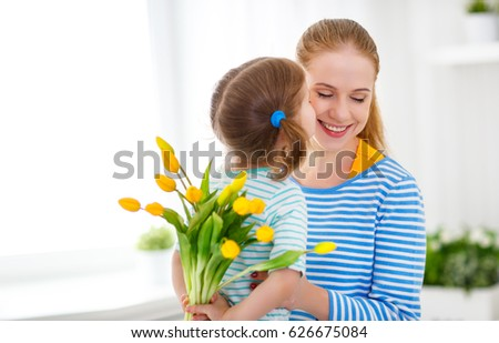 Happy mother's day. Child daughter congratulates moms and gives her a postcard and flowers tulips  #626675084