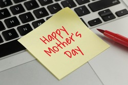 Happy Mother's Day sticky note pasted on the keyboard