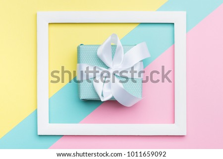 Happy Mother\'s Day, Women\'s Day, Valentine\'s Day or Birthday Pastel Candy Colours Background. Flat lay minimalism geometric patterns greeting card with a gift box.