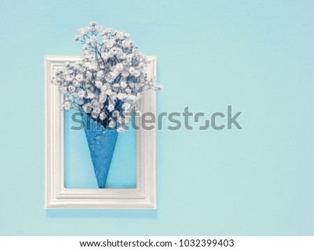 Happy Mother's Day, Women's Day, Valentine's Day. White flowers on a light blue background in a cone ice cream. Creative greeting card. Flat lay, top view, copy space