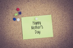 Happy Mother's Day written on sticky note pinned on pinboard