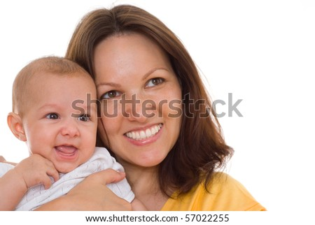 happy mother stands and holds the baby