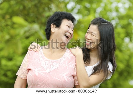 Happy mother talking with her daughter.