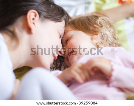 Happy mother with a child - shallow DOF, focus on eyes