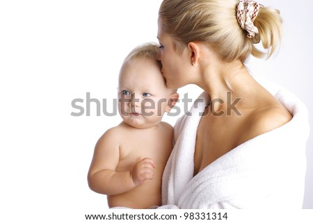 Happy mother with baby boy isolated over white