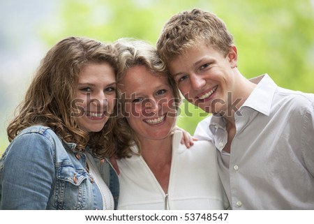 happy mother with daughter and son
