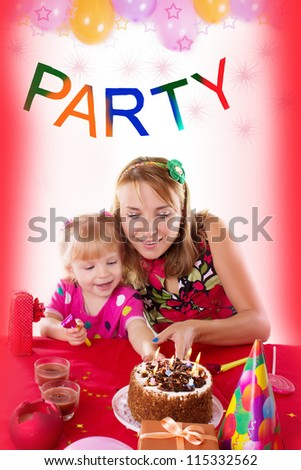 Happy mother with her baby girl celebrating birthday with candles