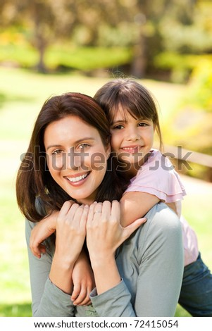 Happy mother with her daughter in the park