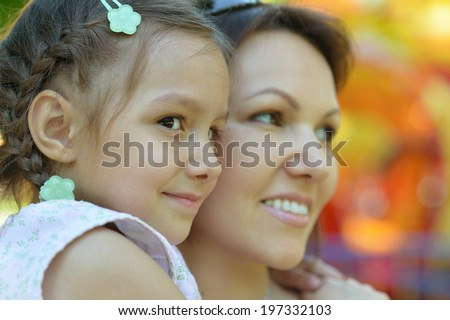 Happy mother with her daughter walk in summer - stock photo