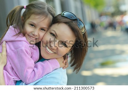 Happy mother with her daughter walk in summer #211300573