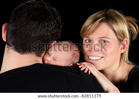 Happy mother with her husband and 18 days old baby