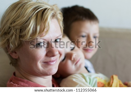 Happy mother with her sons
