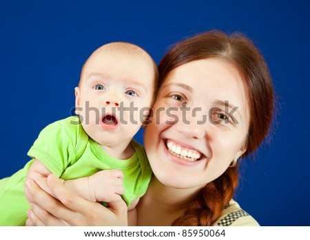Happy mother with  3 month baby over blue background