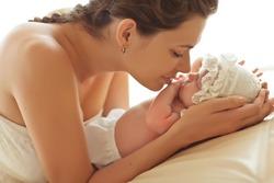 Happy mother with newborn baby