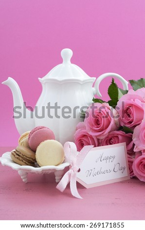 Happy Mothers Day Pink Roses and Tea Pot and tea setting on shabby chic style vintage distressed pink wood table. .