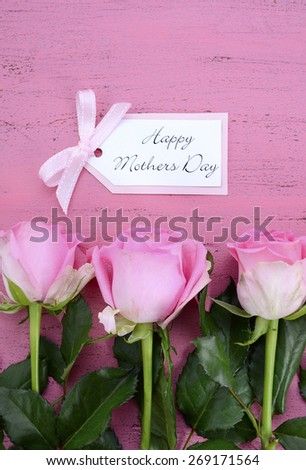 Happy Mothers Day Pink Roses on Vintage style distressed pink wood table with gift tag.
