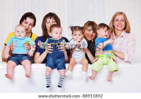 Happy mothers playing with their babies