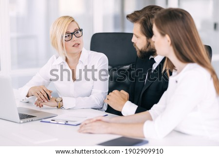 Happy motivated diverse business people work together, collaborate in an office meeting, colleagues discuss financial project ideas in a boardroom briefing. Stockfoto ©