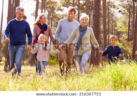 Happy multi-generation family walking in the countryside #316367753
