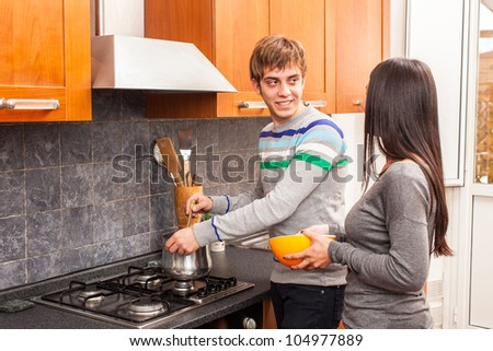 Happy Multiracial Couple in the Kitchen
