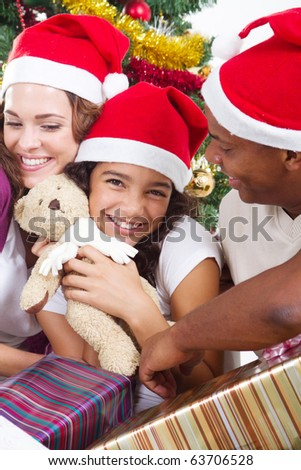 happy multiracial family with gifts at Christmas