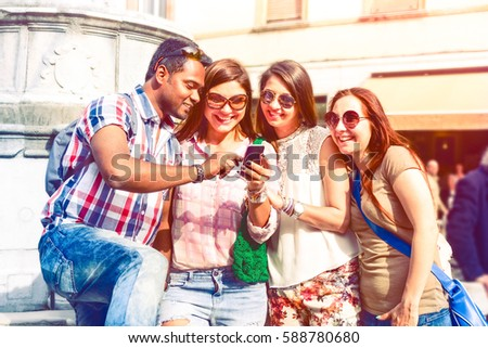Happy multiracial group of friends looking tour city information on mobile phone - Multicultural students searching street map on smartphone app - Concept of tourism and new technologies focus on male