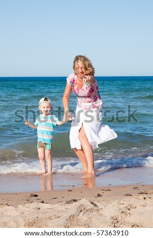 Happy mum and the son on a beach
