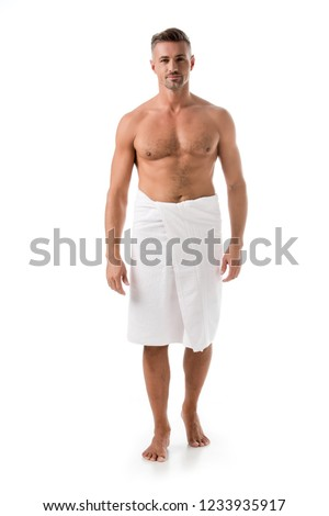 happy muscular shirtless man wrapped in towel posing isolated on white