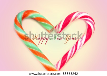 happy new year and candy canes forming a heart