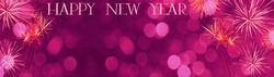 Happy New Year background banner panorama long greeting card template - Festive pink magenta firework and bokeh lights isolated on dark black night sky, with space for text