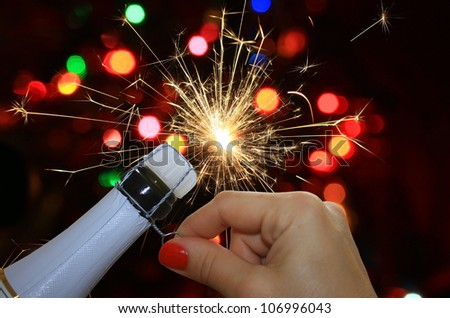 Happy new year background with woman hand opening champagne