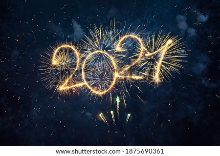 Happy New Year 2021. Beautiful creative holiday web banner or flyer with Golden firework and sparkling number 2021 on night blue sky background.