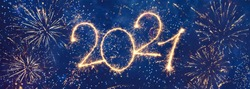 Happy New Year 2021. Beautiful creative Wide Angle holiday web banner or header for website with firework and sparkling number 2021 on blue background