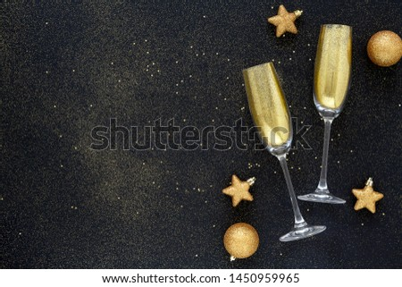 Happy New Year. Beautiful Glowing overlay for holiday greeting card. Flat lay composition. Beautiful Christmas golden trappings on black background. Copy Space.   #1450959965
