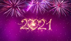Happy New Year 2021. Beautiful holiday creative greeting card or web banner with Golden sparkling number 2021 written sparklers on Magenta background.