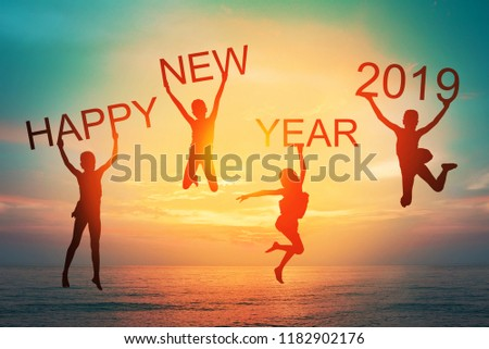 Happy new year card 2019 retro or lomo style. Silhouette of children girl  jumping on tropical beach with vintage sunset sky background. Kids holding the number 2019 with sea and sunrise background. #1182902176