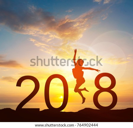 Happy new year card 2018. Silhouette of young girl jump on top of mountain with fantastic sea and sunrise sky. Happy joyful girl jumping as a part of the Number 2018 sign with rising sun background. #764902444