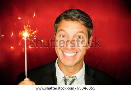 Happy new year celebrating man holding sparkles