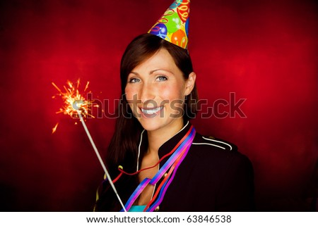 Happy new year celebrating woman holding sparkles