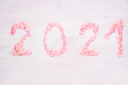 Happy New year 2021 celebration. Bright pink confetti on pink background. Christmas and new year celebration