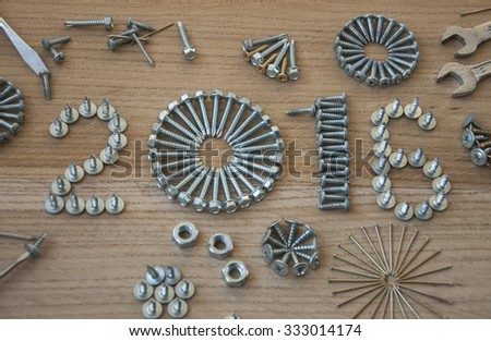 Happy new year 2016 composition with  nails bolts and dowels