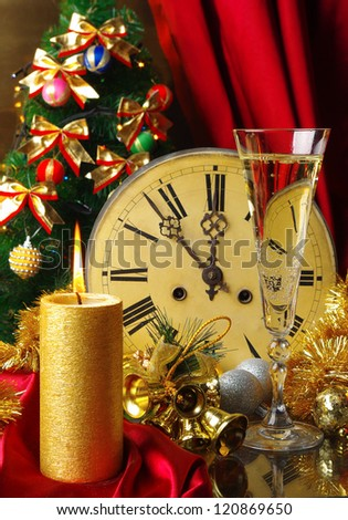 Happy New Year. Composition with old clock, glass of champagne, candle and decorated Christmas tree