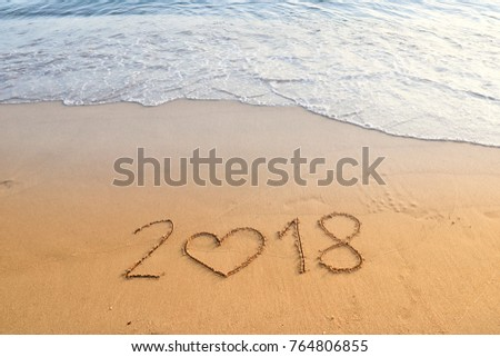 happy new year concept, 2018 written in the sand on a beach. #764806855