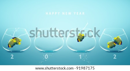Photo of Happy new year 2012, conceptual image angelfish jumping to new fish bowl and creating 2012 year number.