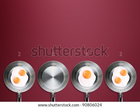 Happy new year 2012, conceptual images Fried eggs in a frying pans creating 2012 year number.