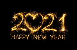 Happy New Year 2021. Creative lettering Happy New Year 2021 with sign heart of sparkling sparklers on black background. Beautiful Glowing overlay template for design holiday greeting card