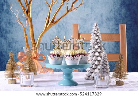 Happy New Year 2017 cupcakes on a modern stylish, festive, blue gold and white Winter theme table setting