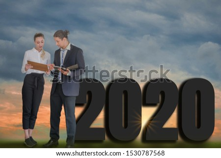 Happy New Year 2020 Digital Trend Concept,businessman and businesswoman stand to discuss company plans,goals and future planning new marketing trending,with background and evening sky