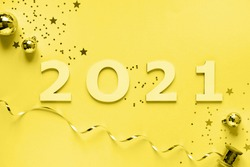 Happy New Year 2021 . Festive Shining  composition on Set Sail Champagne color background.Flat lay, top view, copy space.